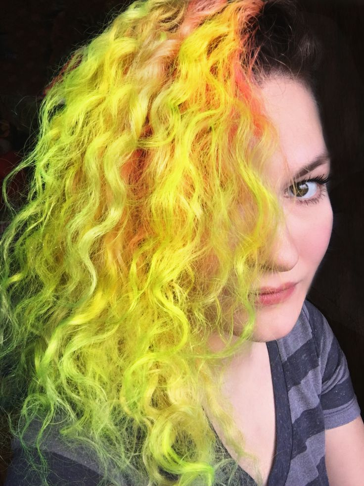 Neon Yellow curly hair with a side shave. Dyed with Pravana Vivids!