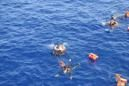 Italy navy says migrant boat flipped, five dead