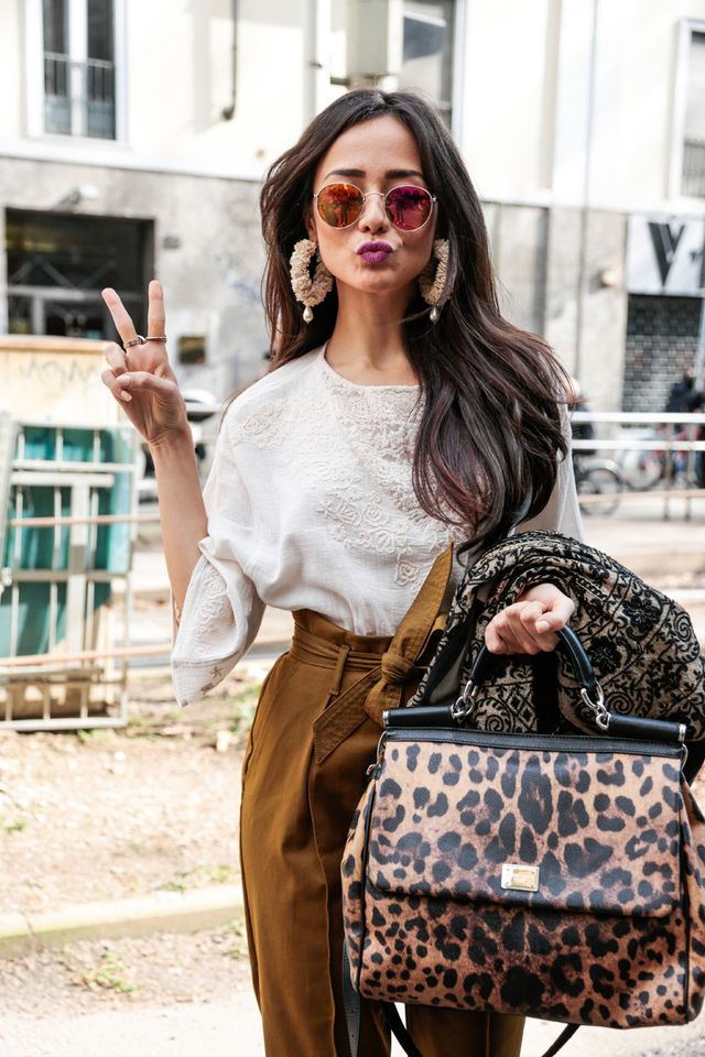 Dolce & Gabbana bag with statement earrings and reflective sunnies.