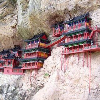 Hanging Monastery - China. It is literally on the side of a cliff and is the only temple which combines the 3 main traditional chinese religions: Buddhism, Taoism & Confucionism.