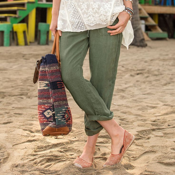 ORGANIA PANTS -- Supremely comfortable linen pants, with front zip and button waistline, drawstring finish and the most charming crochet detail. Easy fit, with roll-tab hem. Four pockets. Linen.