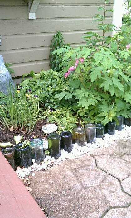 Recycle Your Wine Bottles Into Decorative Flower Bed 400 x 300