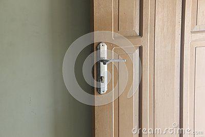 Open door,  door handles and a wall. half of door in front of wall