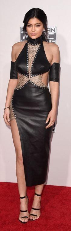 Kylie Jenner: Dress – Bryan Hearns  shoes – Tamara Mellon  Purse – Giuseppe Zanotti