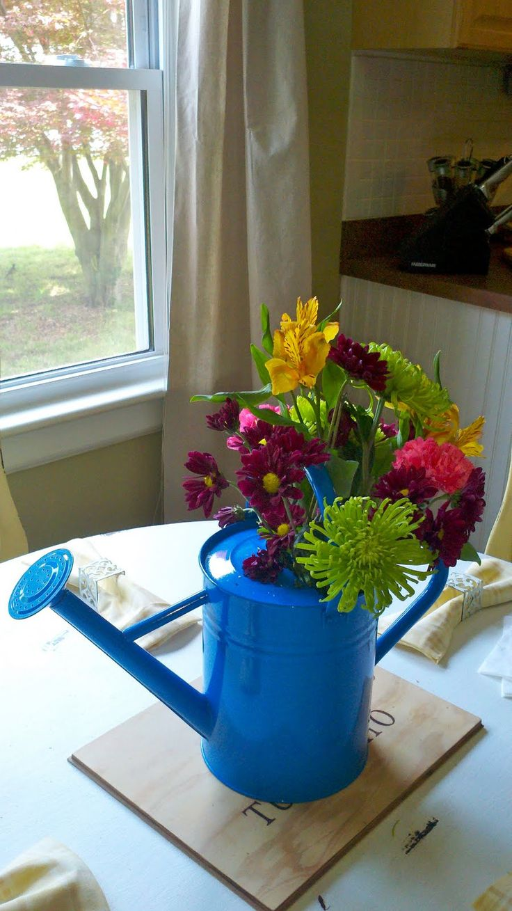 Best watering can centerpieces ideas on pinterest