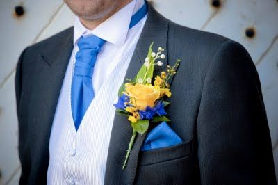 Groom's Illios Rose with Lily of the Valley, Oncidium Orchids & Blue Delphinium Volkerfrieden in a special Boutoniere