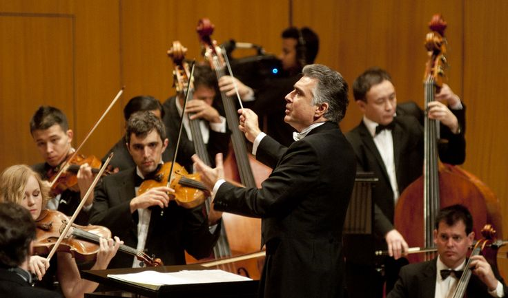 Conductor Mischa Damev takes the podium at the SOI.