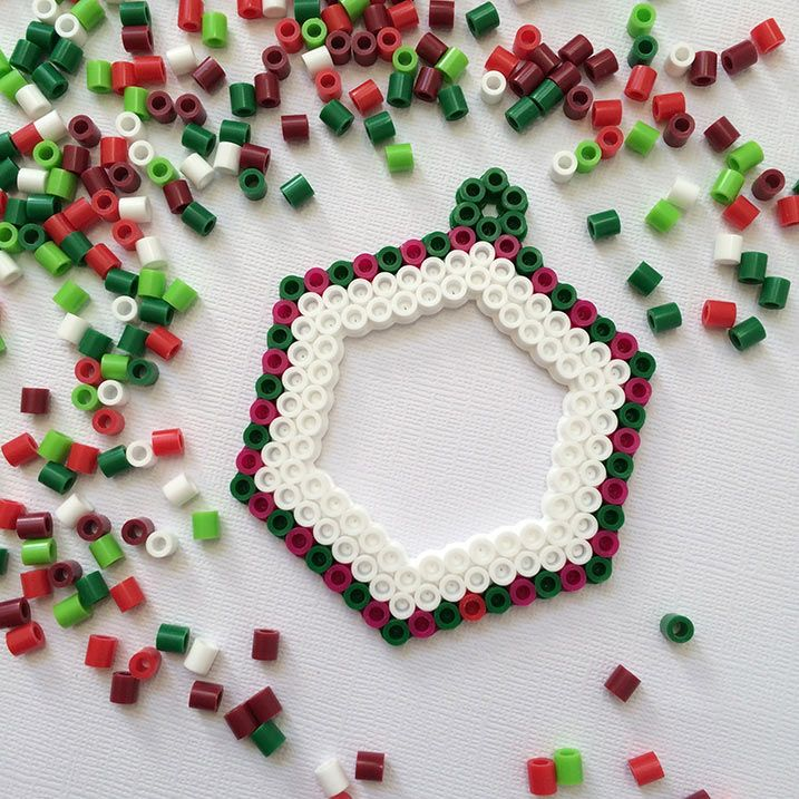 Make a Perler bead shape and leave and opening for the frame