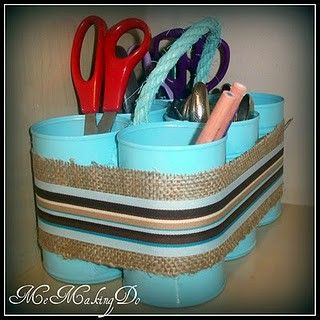 Up-cycle that tin can into a crafting caddy, with rope handles and ribbons around. Spray paint unifies everything. !