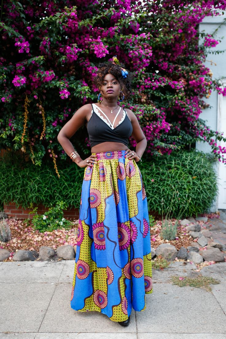 Blogger Dafrastar rocking an Ankara skirt, headwrap and earrings from Skirtsy Box. Crop top from Amazon, bralette from Missguided. Lipstick is Huda Beauty Material Girl.