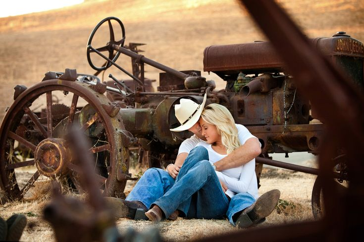 engagement photos...  I love this photo!!  I want one of me and my daddy on one of his old tractors!
