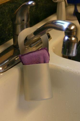Make a convenient sponge holder from a shampoo bottle.