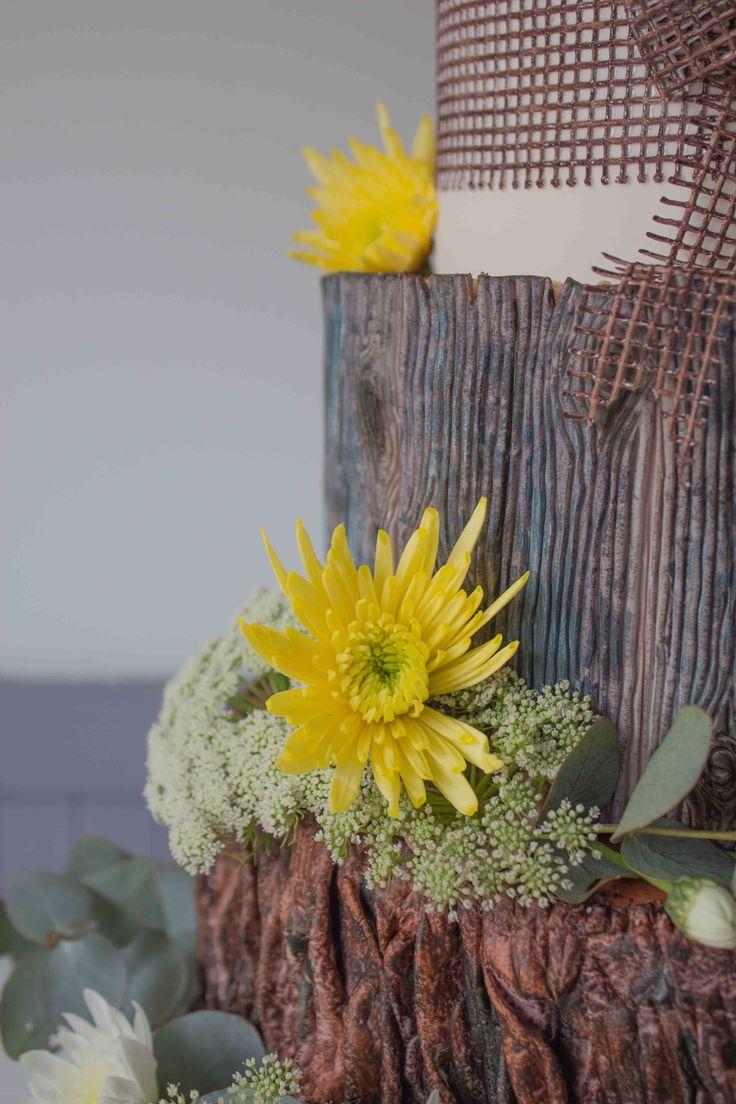 Woodland cake: up-close of a beautiful yellow chrysanthemum.