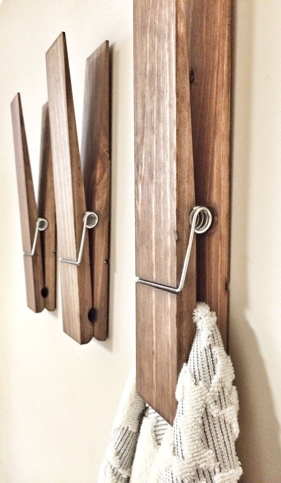What a unique and fun way to hang your towels in your bathroom or laundry room. Can also be a fun way to display photos, kids drawings, or