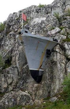 Abandoned Military Base In Murmansk, Russia. Russians dabbling in the Philadelphia Experiment? I would say so. How else would they get that stone mountain to eat that steel ship?