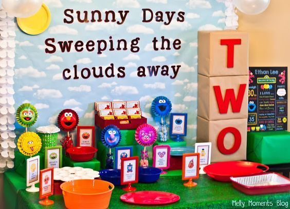 Sunny Days, Sweeping the Clouds Away....Sesame Street/Elmo Themed Birthday Party!  Includes tons of DIY decorations, colorful favors, food tent cards....and much more festive flare.  FREE printables to download at Melly Moments Blog