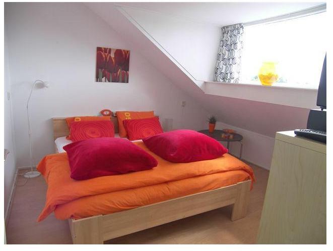 De tweede slaapkamer op de zolder, ook hier weer met dakkapel!