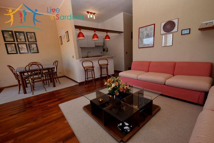 Refurbished chic coastal living room. Who wouldn't want to snuggle into that sofa!  #sardiniaproperties #homeforsalesardinia #appartamentoinvenditasardegna #agenziaimmobiliaresardenga