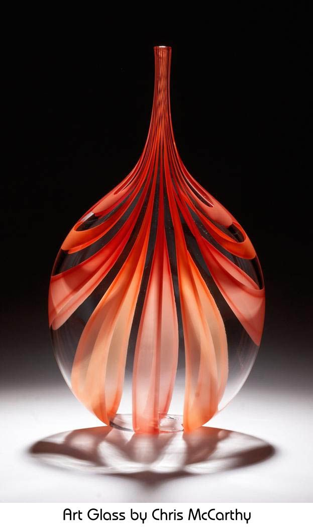 These are some quite unique Art Glass pieces from the works of Chris McCarthy. I love the unique way he incorporates color and I'm crazy about these red and orange flame hues. Chris's Art Glass products are available on Artful Home and Park Avenue Glass.