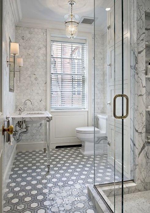 Froghill Designs Blog White carrara marble walls, mosaic tile floor, white pedestal sink, beautiful lighting, chandelier and sconces, glass shower, #gorgeous bathroom #whitebathroom #carraramarble