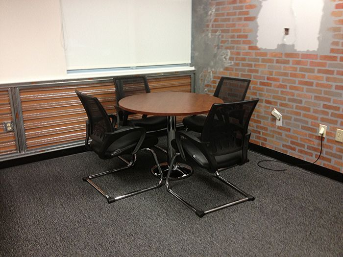traditional and functional office furniture pieces were used to fill the space with all essentials s