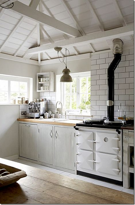 AGA - a great starting point at Fern Villa- with simple cabinetry and subway tiles.