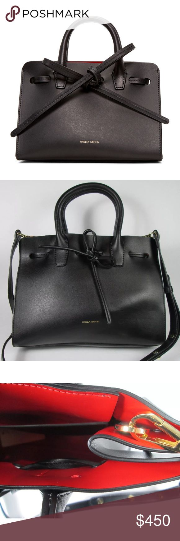 Auth Mansur Gavriel Black Mini Sun Crossbody Bag Authentic Mansur Gavriel Black/Flamma Mini Sun Crossbody Bag. Vegetable-tanned leather tote. Twin rolled carry handles. Detachable and adjustable shoulder strap with lanyard clasp fastening. Logo stamp in gold-tone at face. Self-tie drawstring at throat. Patch pocket at interior. Leather interior in 'flamma' red. Gold-tone hardware. Tonal stitching. Appx. 29 cm L x 23 H x 13 W x 117-121 Strap Drop. Made in Italy. Gently used with only light…