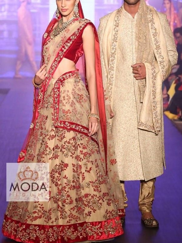 A stunning A-line red and golden beige colour bridal lehenga for a beautiful bride.