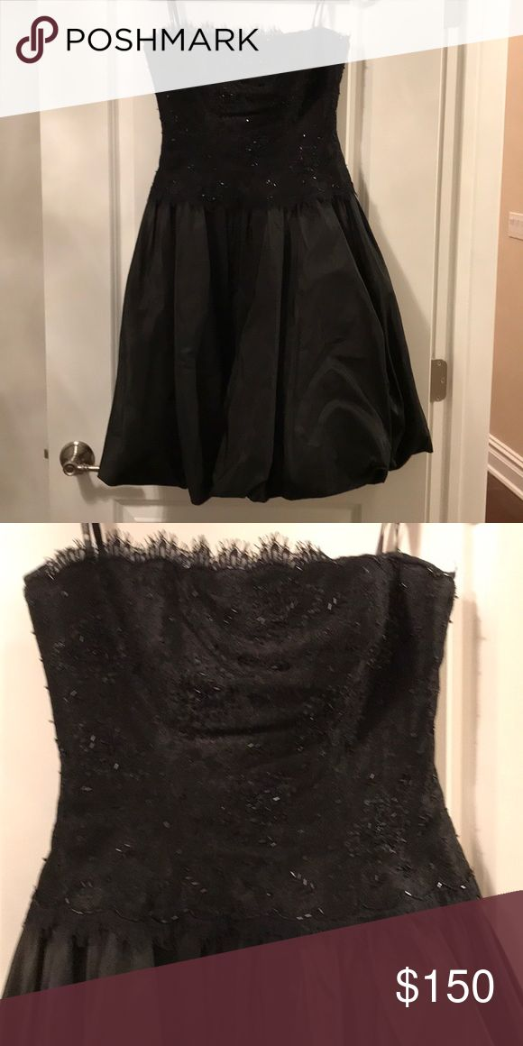 Tadashi black strapless dress Black sequin dress. The top of the dress is black lace with beading and sequins. Bottom portion of dress poofs out. Perfect for a black tie affair.  Size 8. Tadashi Shoji Dresses Strapless