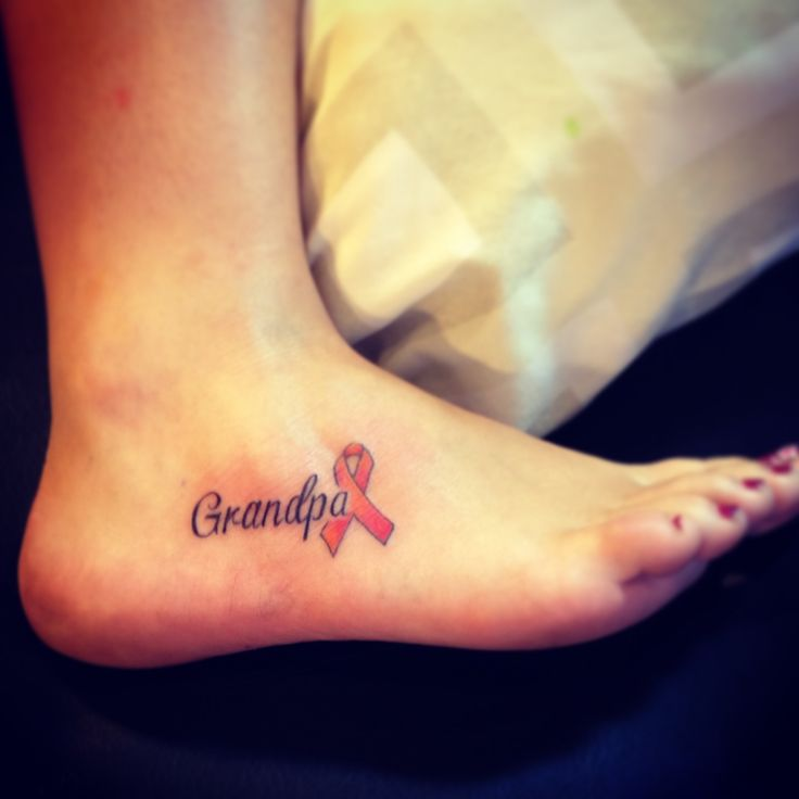 Grandpa tattoo leukemia ribbon.  This is the one I'm getting, but putting Nicole's name.