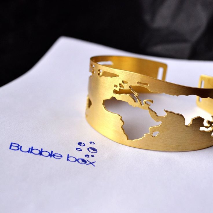 It's time for a new adventure!  ft. our #Globe bracelet with #world cutting!  Find it in our shop!  #bubblebox #wanderlust #handmadejewelry #travelbracelet #worldjewelry #worldcuff #travelmore #worldtraveler #jewelrymaker #greekdesigner #worldmap