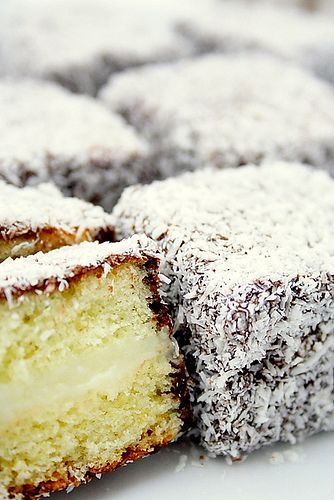 lamingtons filled with vanilla custard: a sponge cake with chocolate coating and custard filling.