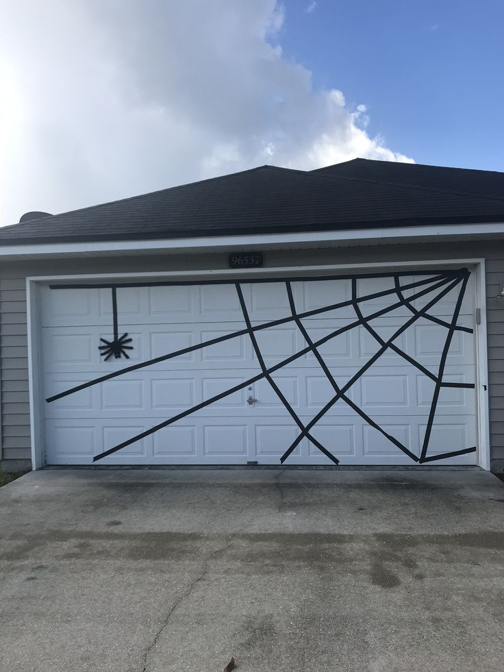 Halloween Garage Door Spider Web Using 2 Inch Black Painters Tape Dollar Tree Halloween Outdoor Decorations Garage Door Halloween Decor Halloween Diy Outdoor