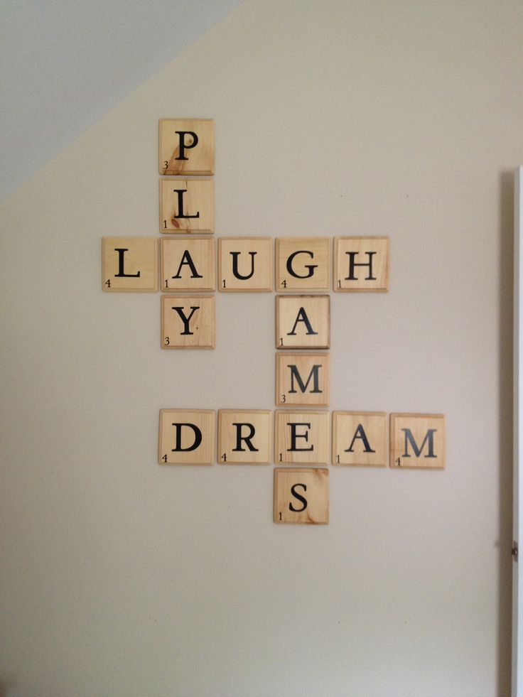 made these scrabble letters from blocks of wood from hobby lobby stained then used the cricut