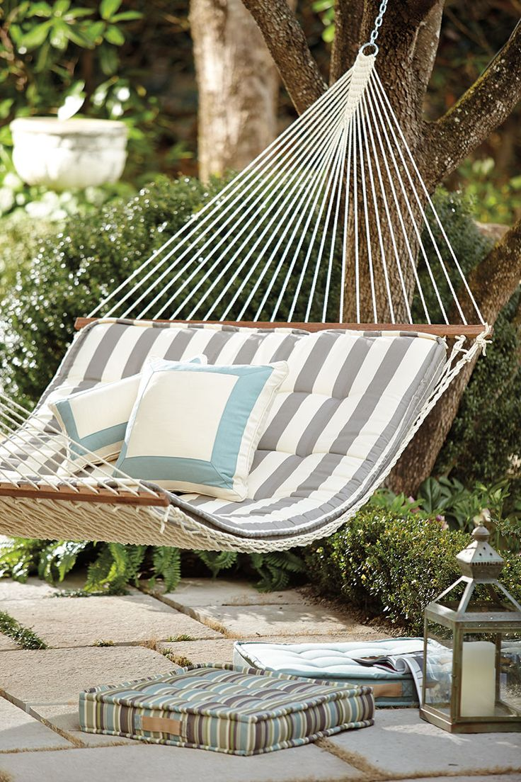Outdoor hammock with striped cushion