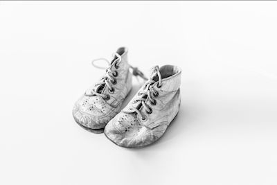 A white photography of childrens shoes. Available as poster at printler.com, the marketplace for photo art. Photographer Patrik Thynell.