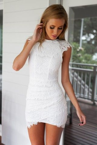 High neck style dress  Amazing lace outer layer detail  Fully lined  Invisible center back zip opening  Stretch fit bodycon style  Slight side gathered detail on front skirt   Model wears size 8  Model height: 165cm without heels  Length of size 10 dress (shoulder to hem): 86cm