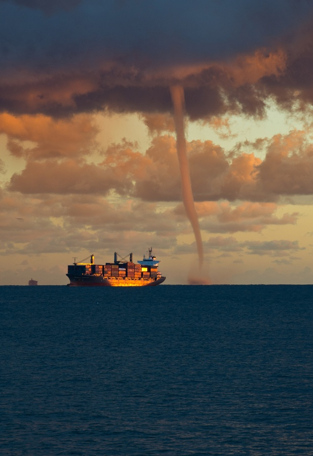 Sudden offshore waterspout by Francesco Magoga