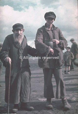 poland woman with jug elderly man
