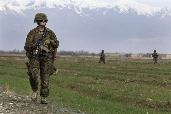 U.S Marine Corps Cpl. Bailey A. Hardiman patrols through a field with Czech and Afghan soldiers near Bagram Airfield, Afghanistan, March 24, 2017. Hardiman is a liaison officer assigned to the Georgian Liaison Team, Rotation Four. Hardiman is filling an infantry billet where she works as the liaison officer for the Czech military patrols. Army photo by Sgt. 1st Class LaSonya J. Johnson