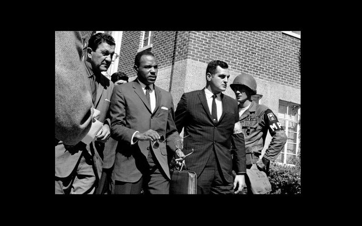 James Meredith is escorted to the University of Mississippi campus by U.S. marshals on October 1, 1962.