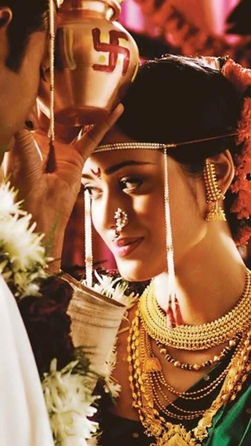 Indian Maharashtrian bride wearing traditional bridal saree and jewellery