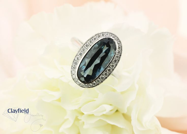 stunning london blue topaz with diamond halo