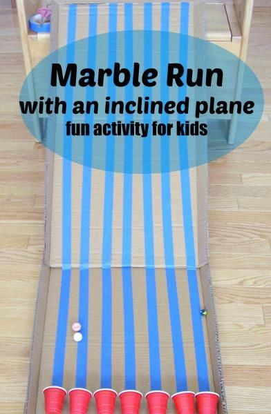Marble run with inclined plane using cardboard and disposable cups. - Preschool Toolkit