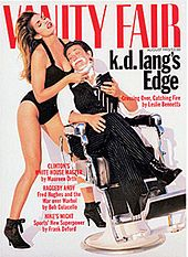 Cover of Vanity Fair from 1993 showing short-haired k.d. lang sitting in a barber chair with shaving foam on her chin, reclining wearing a p...