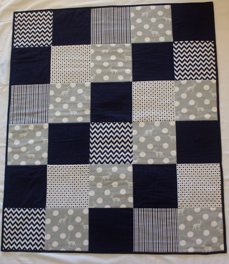 Modern baby boy quilt. Grey and navy with elk print by emmyjdesign