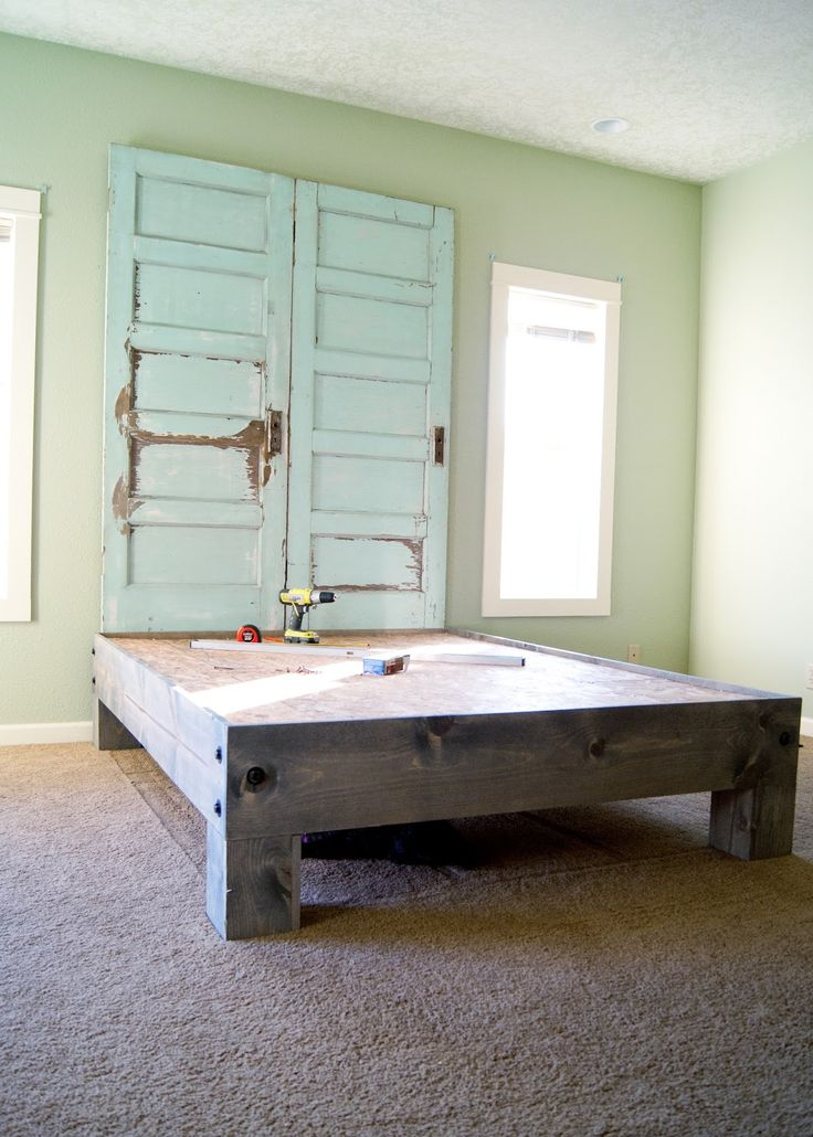 this is the basic design for our bed I've been dreaming about in my head...but with large industrial casters on the legs & the old barn wood we salvaged - DIY Platform Bed & Salvaged Door Headboard {part two} | Averie Lane: DIY Platform Bed & Salvaged Door Headboard {part two}