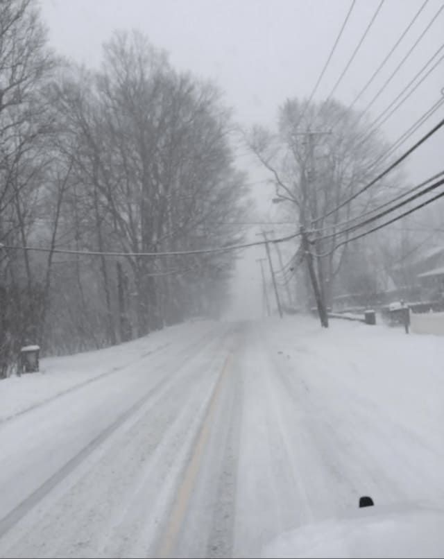 Snow-covered Route 35 in Yorktown from Ridge Street in the early afternoon Tuesday.