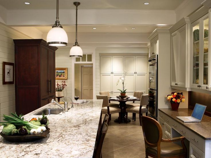 This multitasking kitchen serves up sophisticated traditional style, from the cream cabinets and handsome armoire to the spacious island and desk nook.