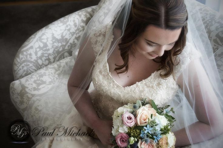 Bride with flowers.  #wedding #photography. PaulMichaels www.paulmichaels.co.nz photographers